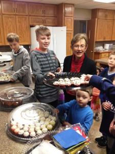 Feeding kids cupcakes